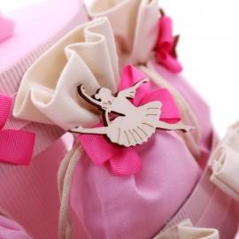 Ballerina Bomboniere Prima Comunione su torta sacchetti con applicazione danzante in legno e confetti crispo.